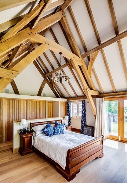 oak frame vaulted ceiling in a bedroom