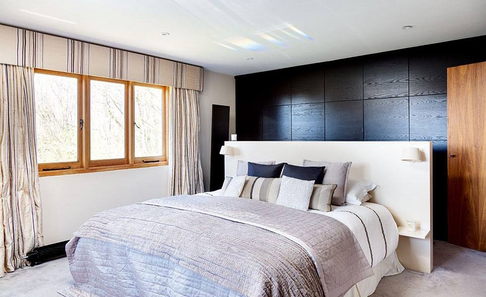 country style bedroom with a wooden feature wall