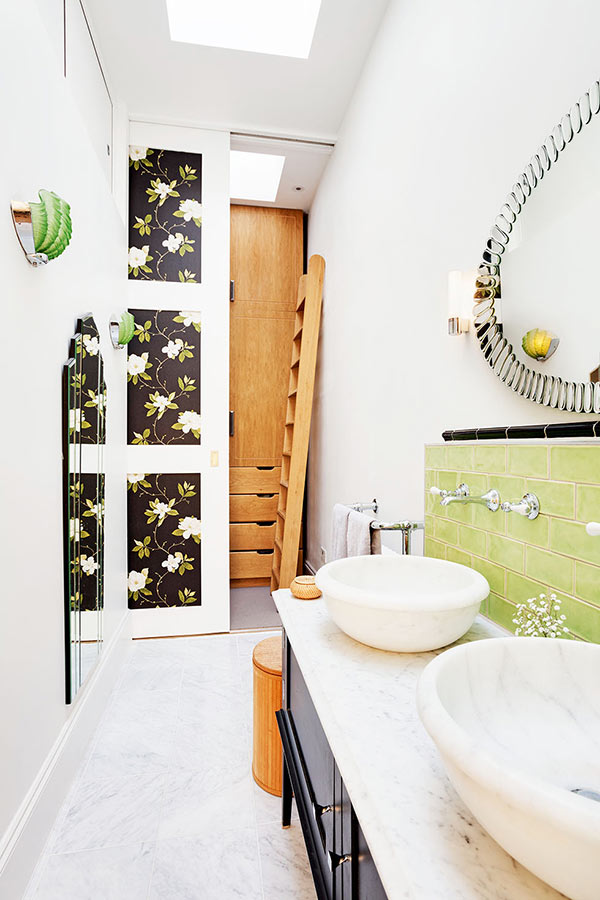 en suite bathroom with a sliding wall in a renovated Victorian house