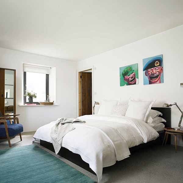 simple white bedroom with a focus on art