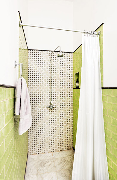 green tiled Victorian bathroom in a victorian renovated flat
