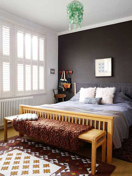 stylish family bedroom with a charcoal feature wall