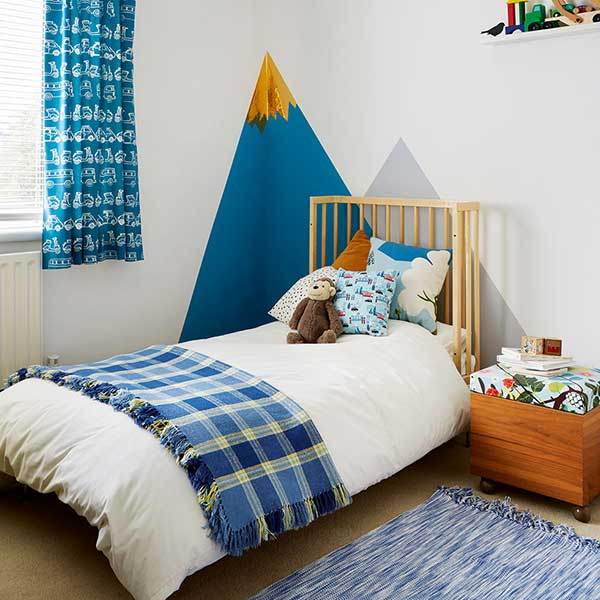 children bedroom with geometric shapes painted on wall