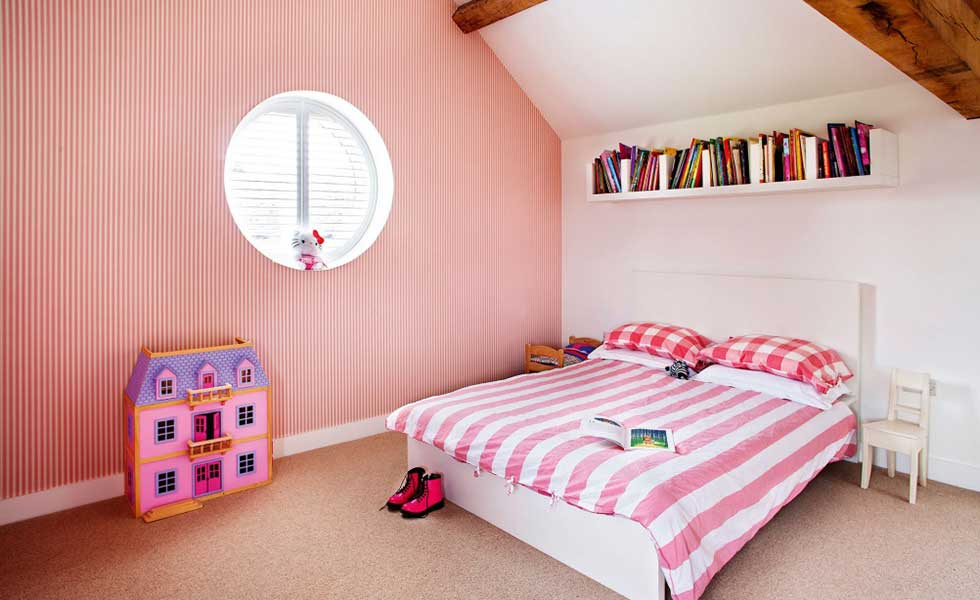 pink and white pinstriped bedroom for children
