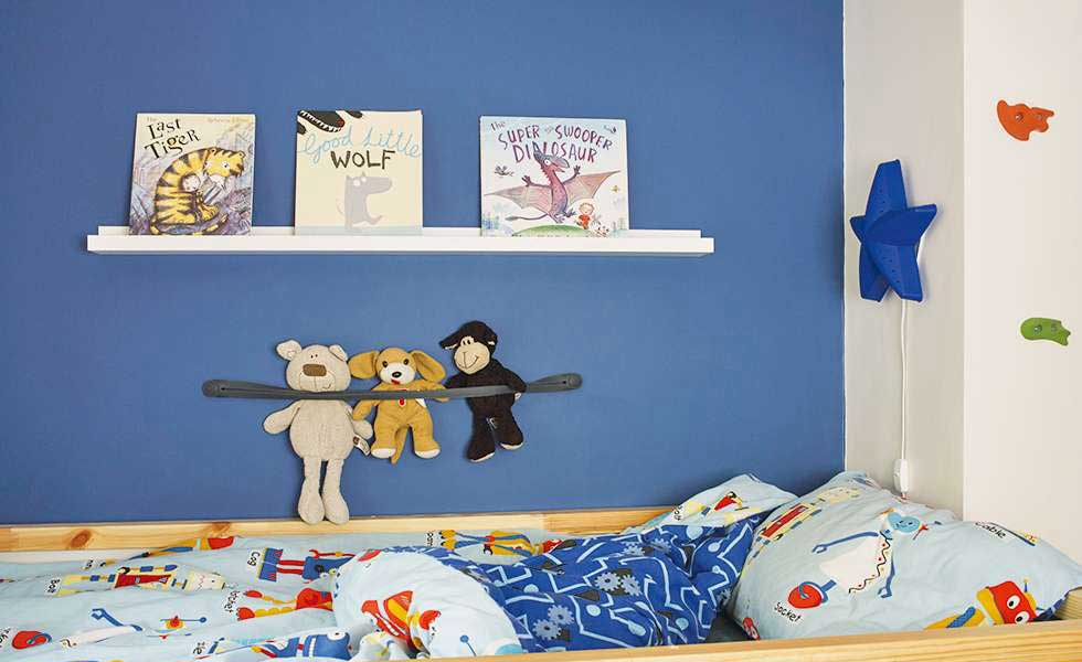 blue children bedroom with nightlight and book shelves