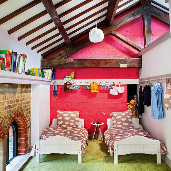 children bedroom with bright pink feature wall