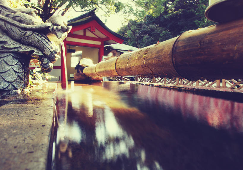 a beautiful and mysterious buddhist shrine temple in japan with a dragon statue