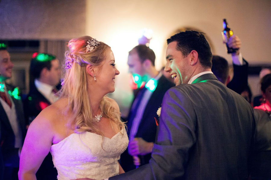 An orange themed wedding at The Cooper's Arms in Aston on Trent with orange decorations with natural wedding photography