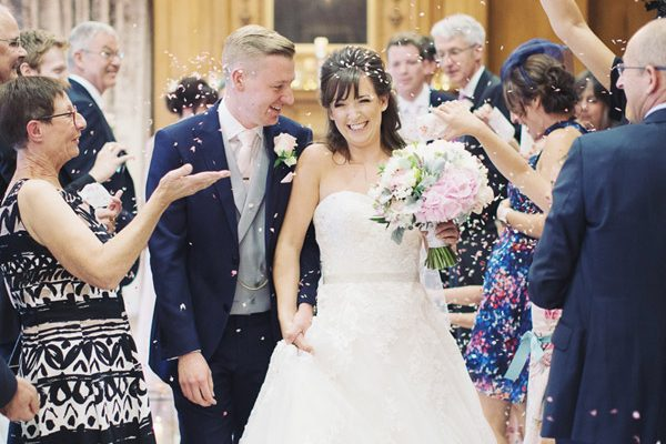 A elegant traditional wedding venue The Grand Hotel York with Yorkshire Sheffield natural wedding photography of the indoor confetti throw
