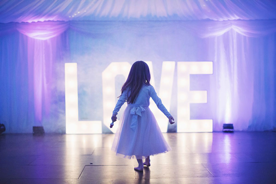 Giant LOVE light letters at Yorkshire wedding venuewith natural wedding photography by Sasha Lee Photography
