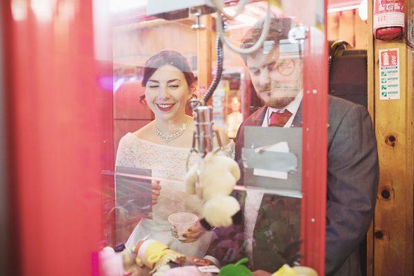 Matlock Bath wedding | Amusement park penny slot machine bride and groom shoot | Matlock Bath wedding photographer | Natural wedding photography