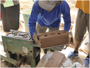 Community members making bricks for their new homes. Photo: Anglican Alliance