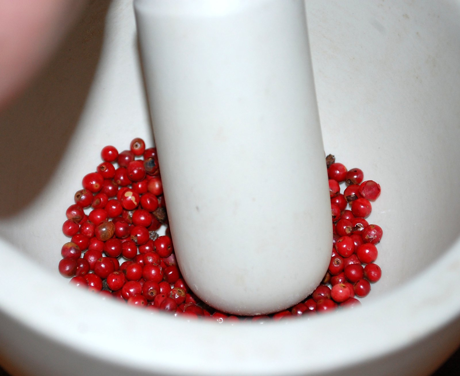 Crushing Pink Peppercorns In Pestle And Mortar