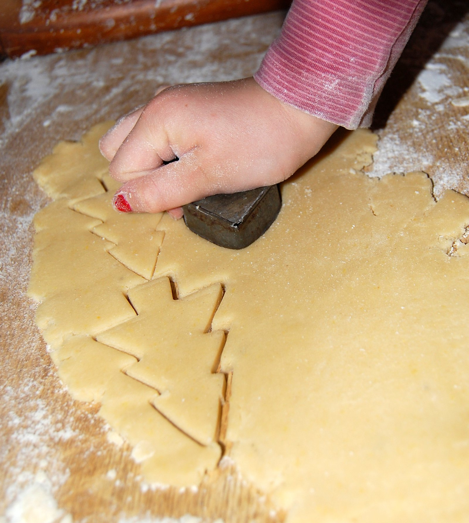 Cutting out Christmassy biscuit shapes