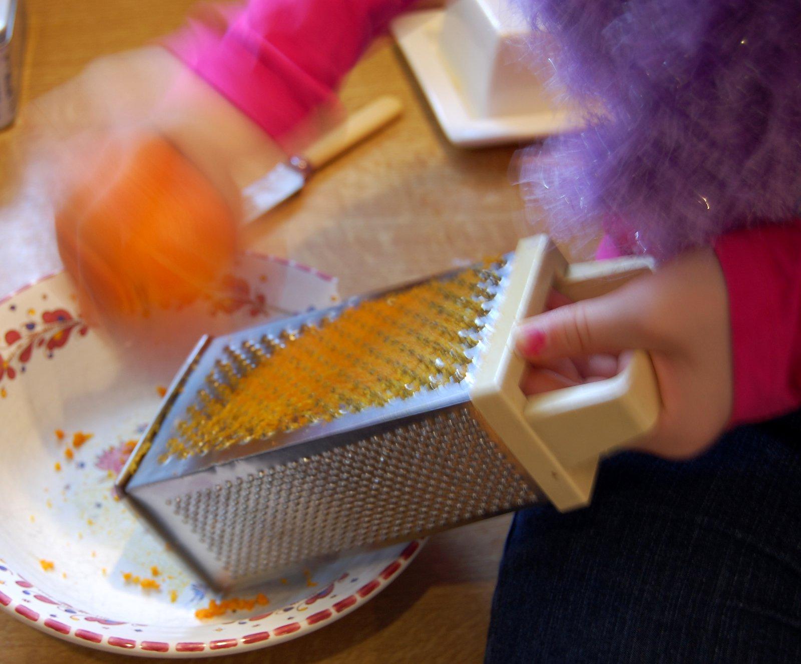 Grating an orange