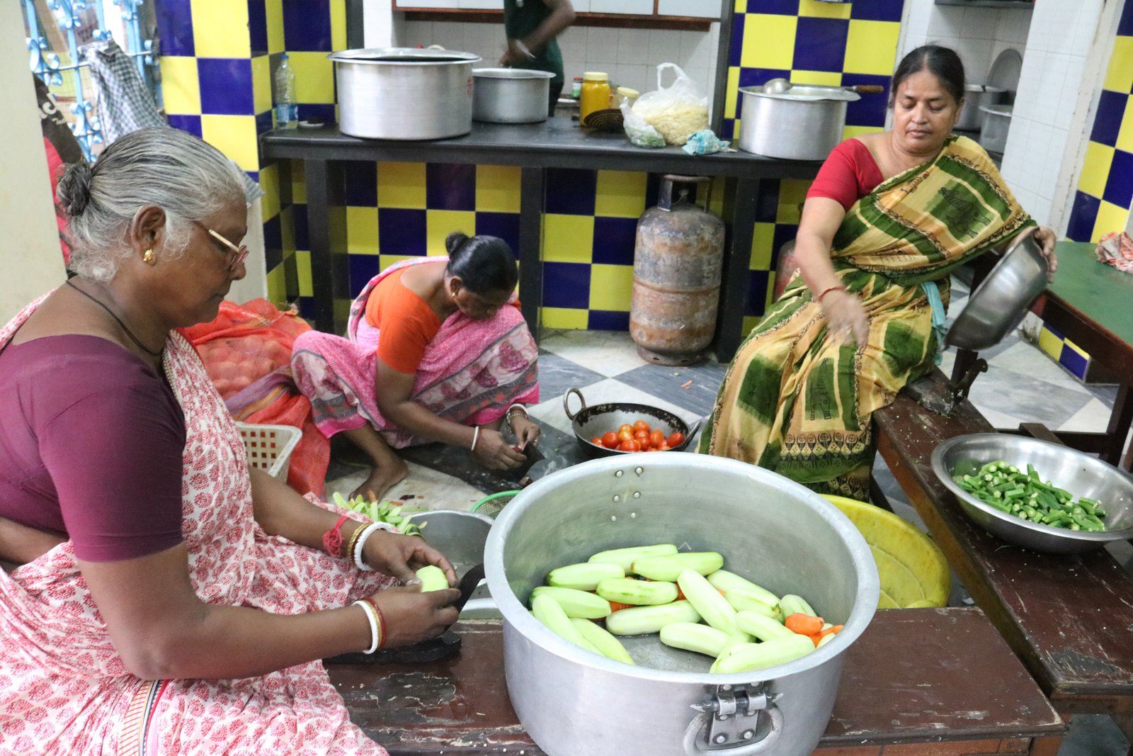 These are Anna's cookery teachers where she learnt how to create traditional everyday Bengali food to feed the children