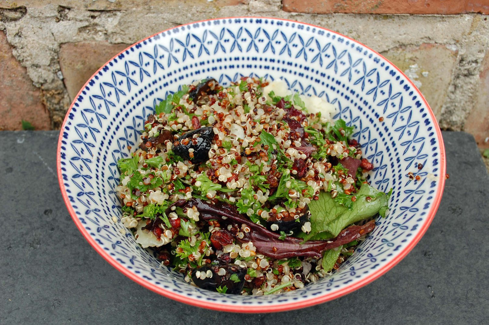 Quinoa Salad With Pomegranate Seeds, Olives And Parsley