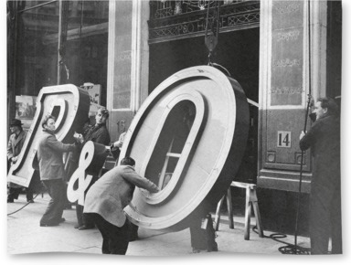 Installation of a new neon sign for P&O in 1956