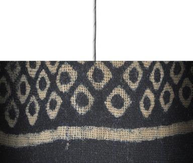 Textile fragment imitating bandhani or tie-dye.