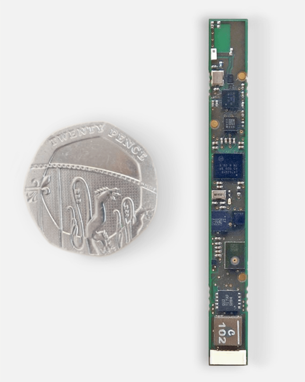 A circuit board next to a 50 pence to represent our medical device design capabilities
