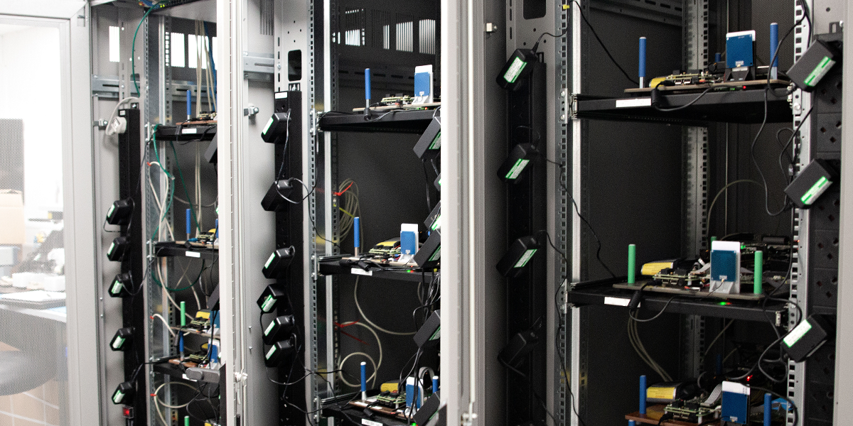 View of racks where software automated testing of a PoC diagnostics device is