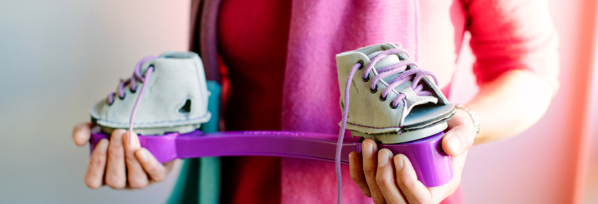 View of a child's clubfoot brace in purple