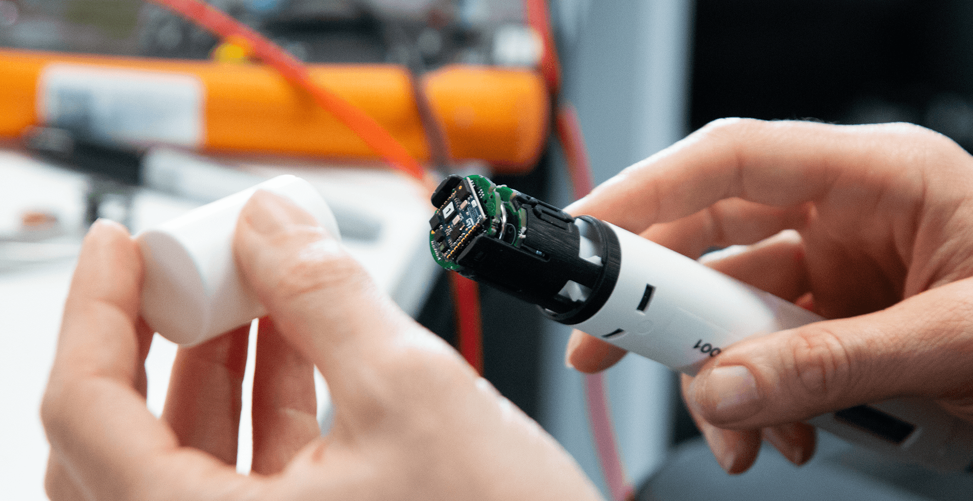 Hands developing a connected auto injector pen device