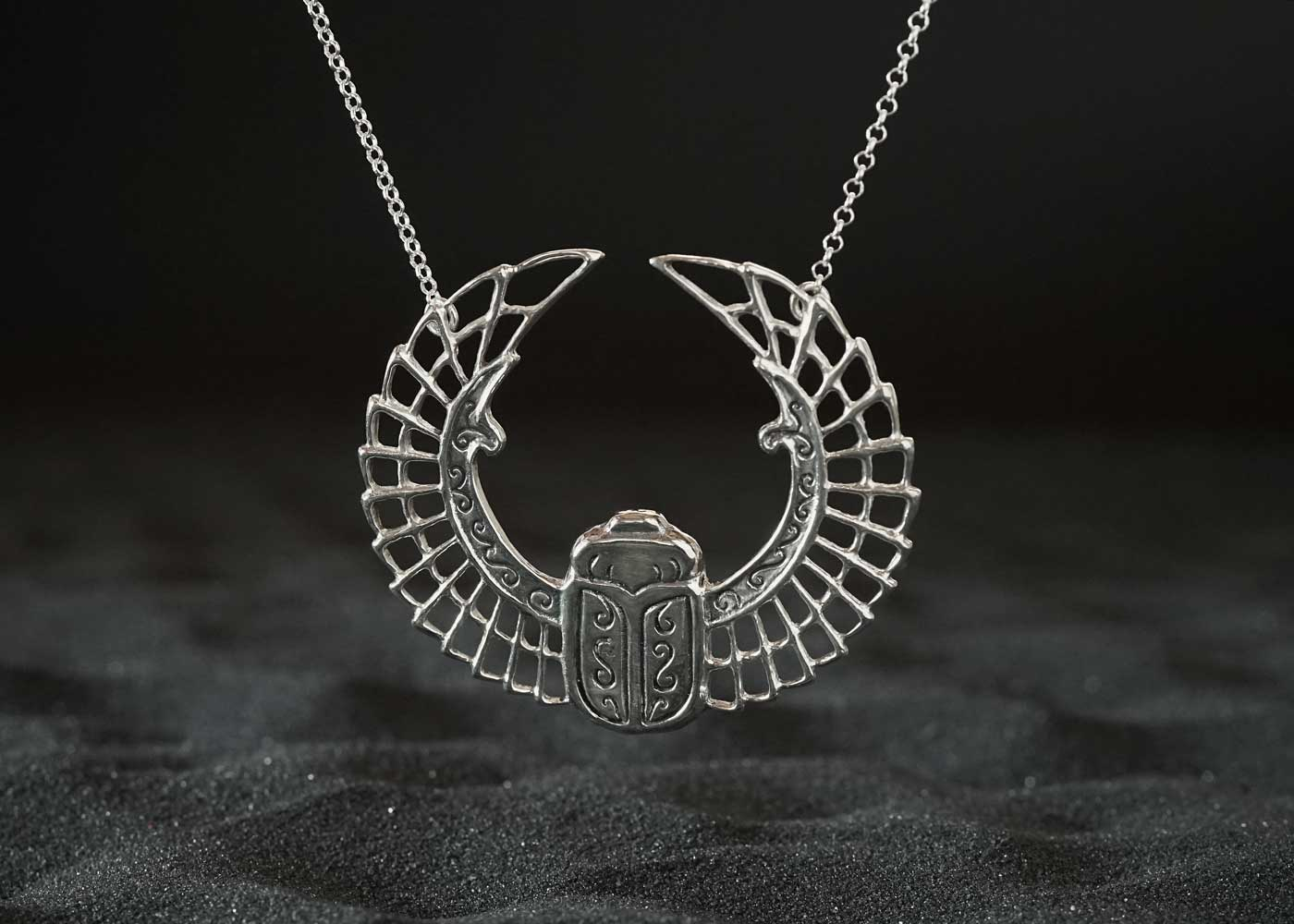 Telos Magic Scarab Web Silver Front Sand View.jpg