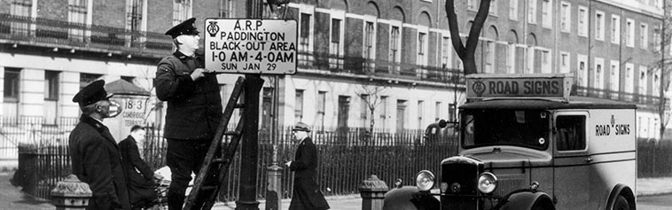 Putting up road signs - 1905