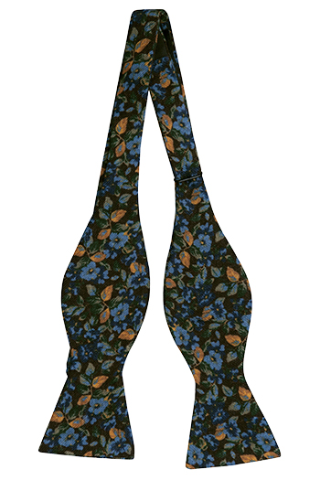 Oknuten Fluga i Ull - Blommönster i brunt, blått, gult och vitt