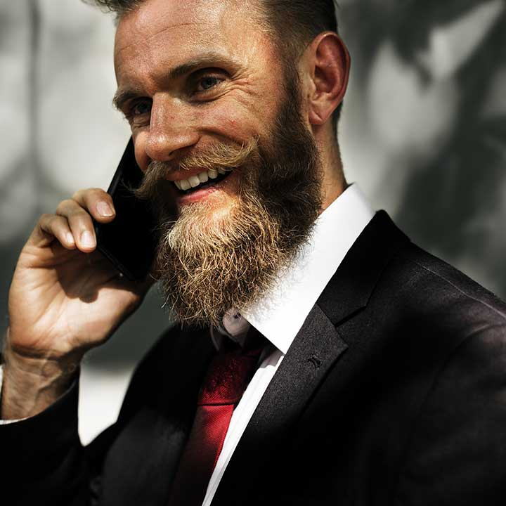 Businessman with beard on hold