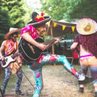 El Pincho Gringo performing at Camp Wildfire. A summer weekend break in a forest near London and Kent. An outdoor woodland retreat featuring adventure activities, live music, DJs, parties and camping. Half summer adventure activity camp, half music festival, for adults only.
