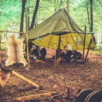 Survival activity at Camp Wildfire. A summer weekend break in a forest near London and Kent. An outdoor woodland retreat featuring adventure activities, live music, DJs, parties and camping. Half summer adventure activity camp, half music festival, for adults only.