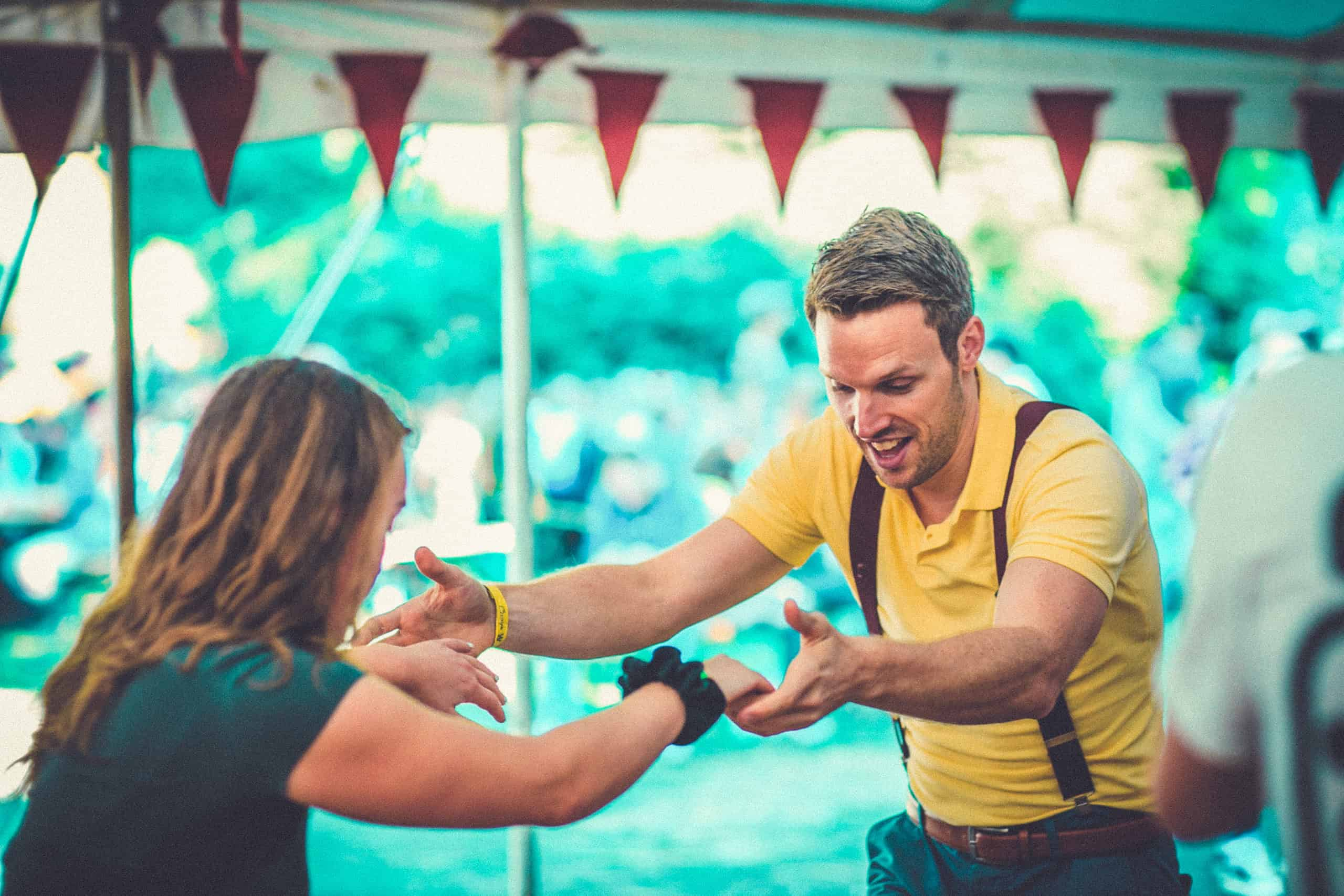 Swing dancing in action at Camp Wildfire. A summer weekend break in a forest near London and Kent. An outdoor woodland retreat featuring adventure activities, live music, DJs, parties and camping. Half summer adventure activity camp, half music festival, for adults only.
