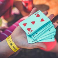 Deck of cards at Camp Wildfire. A summer weekend break in a forest near London and Kent. An outdoor woodland retreat featuring adventure activities, live music, DJs, parties and camping. Half summer adventure activity camp, half music festival, for adults only.