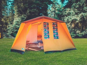 3 man vintage style orange tent. A summer weekend break in a forest near London and Kent. An outdoor woodland retreat featuring adventure activities, live music, DJs, parties and camping. Half summer adventure activity camp, half music festival, for adults only.