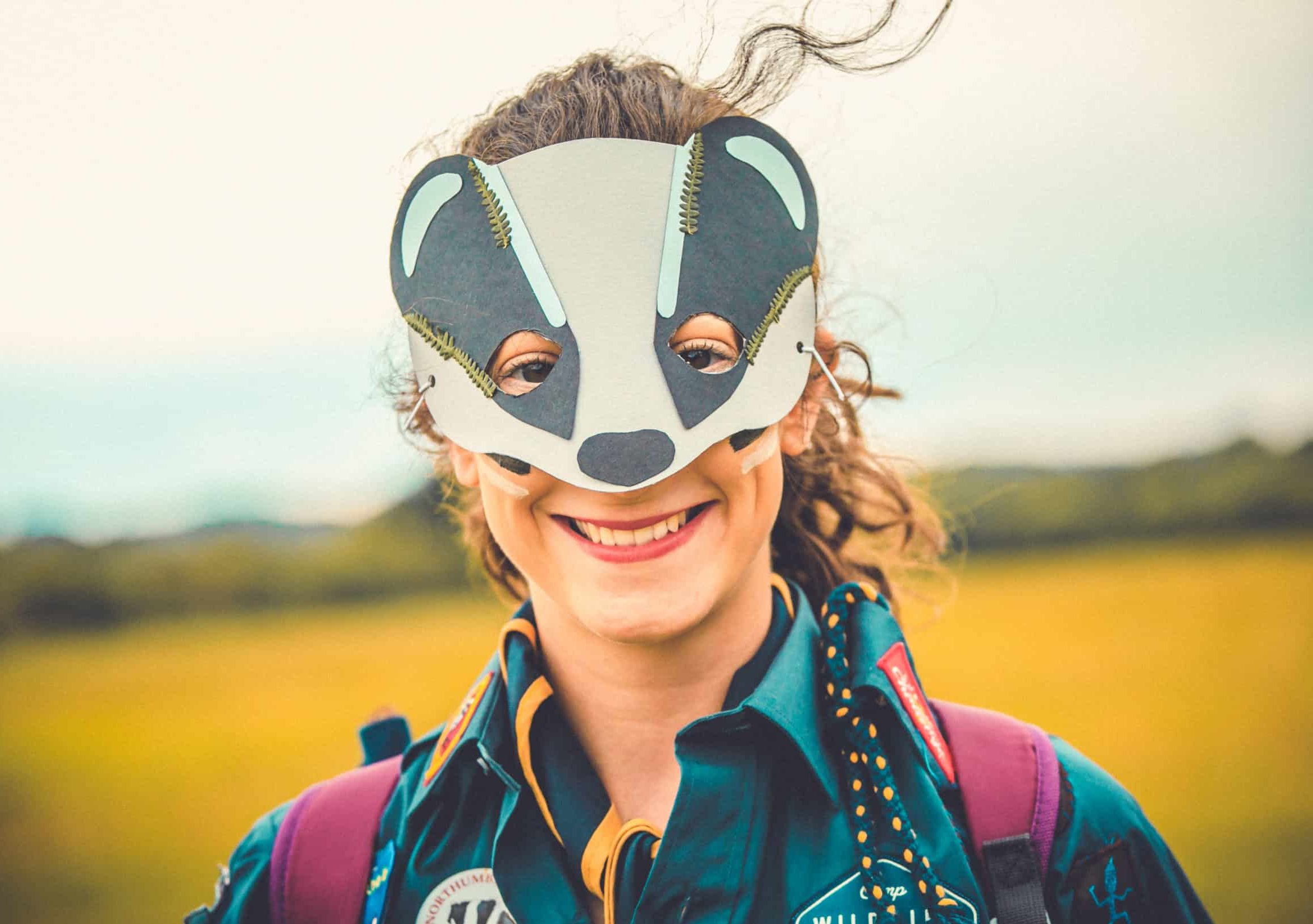 A patrol member wearing her badger mask she made at the mask making activity at Camp Wildfire. The UK's Best Alternative Festival. UK's Top Unique Event. A summer weekend break in a forest near London and Kent. An outdoor woodland retreat featuring adventure activities, live music, DJs, parties and camping. Half summer adventure activity camp, half music festival, for adults only.