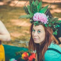 Girl with homemade natural headpiece on at Camp Wildfire. A summer weekend break in a forest near London and Kent. An outdoor woodland retreat featuring adventure activities, live music, DJs, parties and camping. Half summer adventure activity camp, half music festival, for adults only.