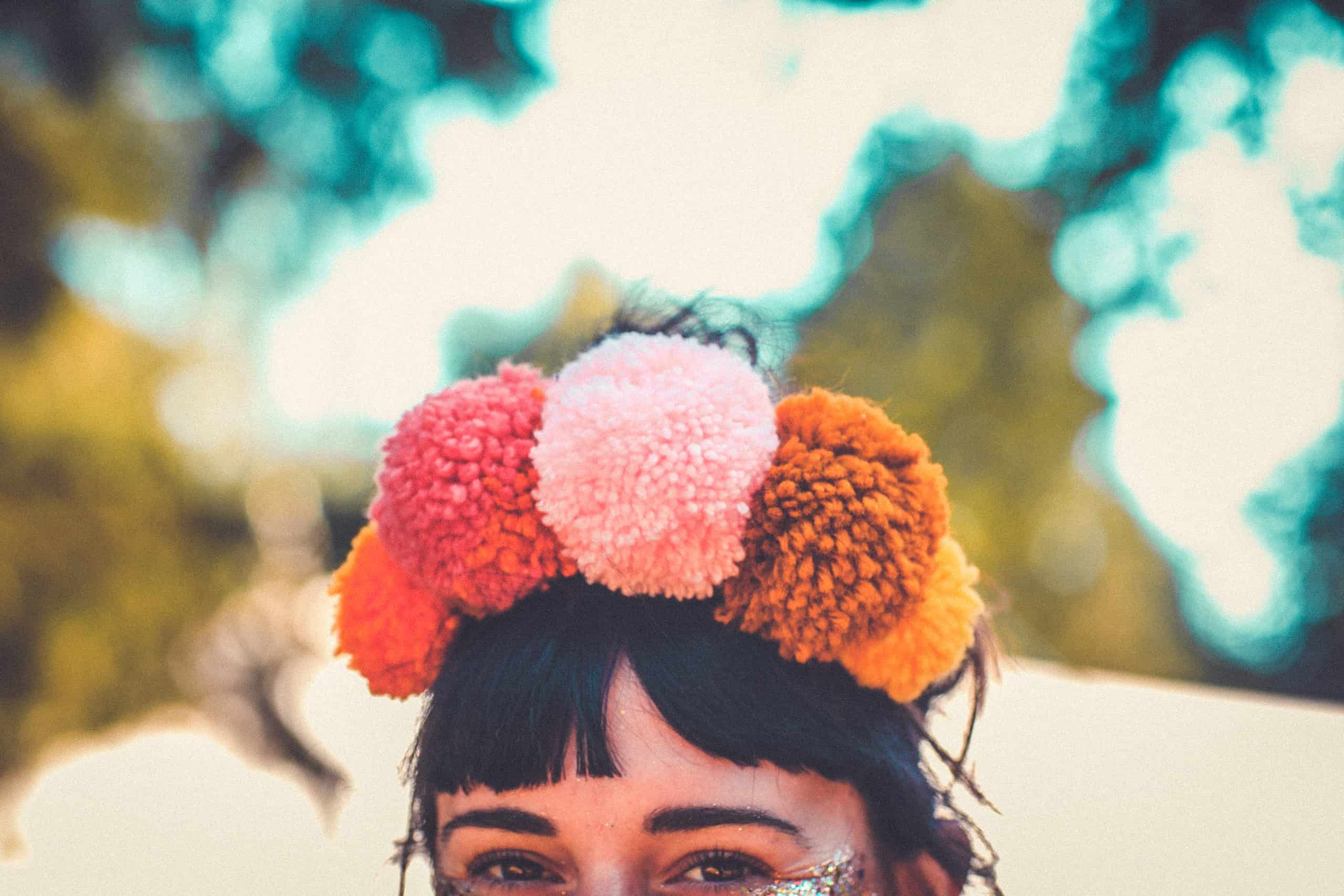 Close up of a hand crafted pom pom headdress at Camp Wildfire