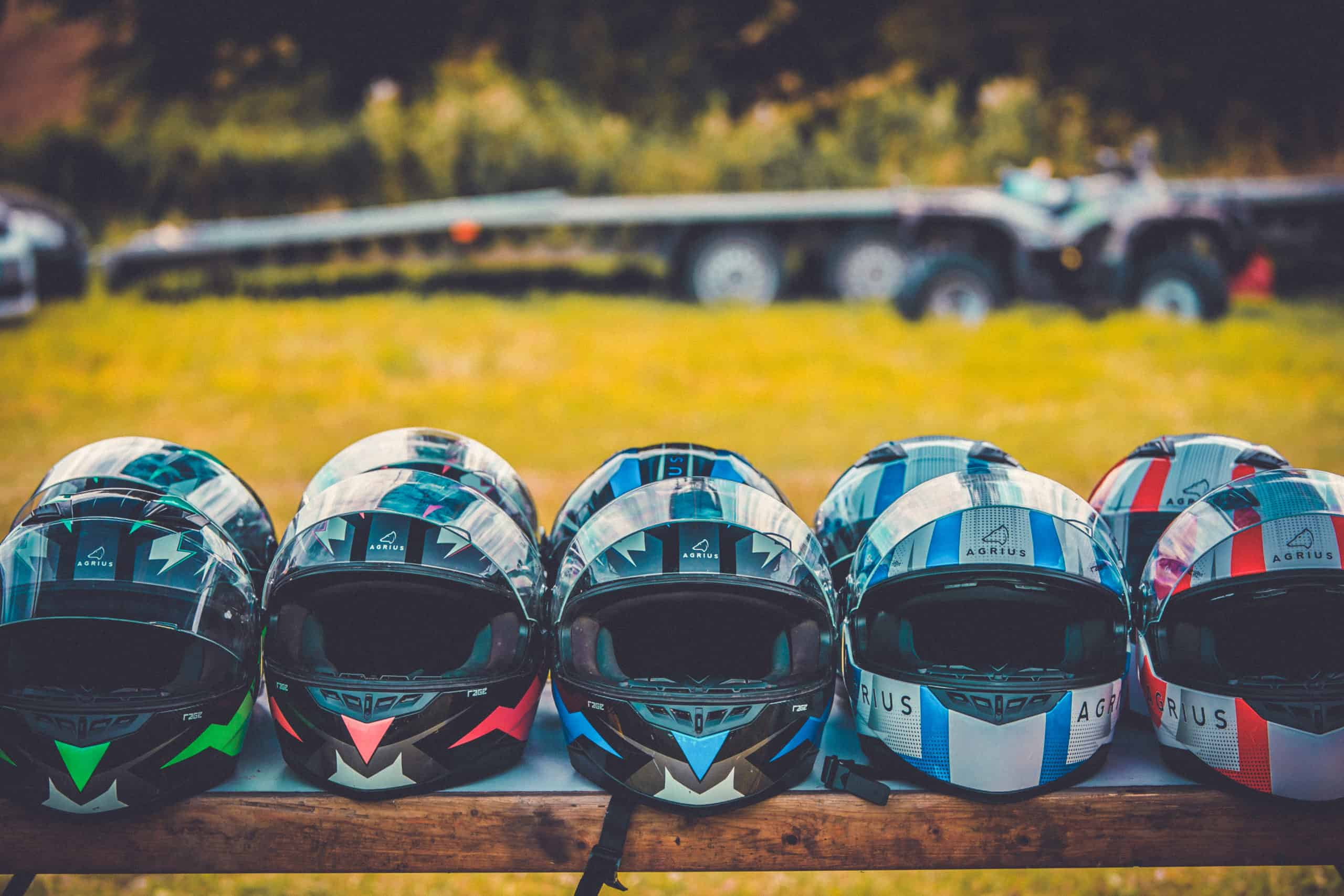 Helmets lined up outside on a bench at Camp Wildfire. The UK's Best Alternative Festival. UK's Top Unique Event. A summer weekend break in a forest near London and Kent. An outdoor woodland retreat featuring adventure activities, live music, DJs, parties and camping. Half summer adventure activity camp, half music festival, for adults only.