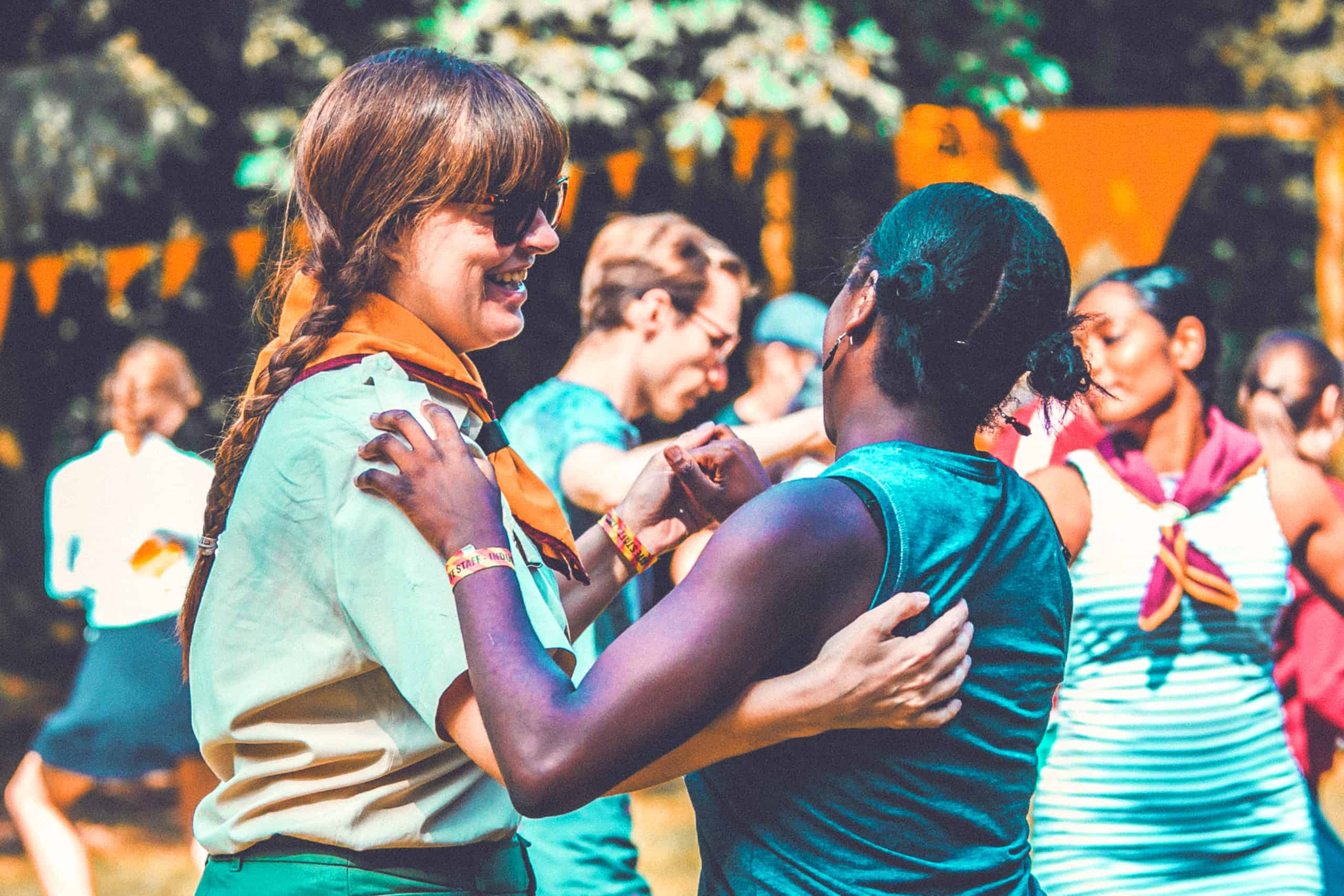 Girls learning some swing dancing at Camp Wildfire. The UK's Best Alternative Festival. UK's Top Unique Event. A summer weekend break in a forest near London and Kent. An outdoor woodland retreat featuring adventure activities, live music, DJs, parties and camping. Half summer adventure activity camp, half music festival, for adults only.