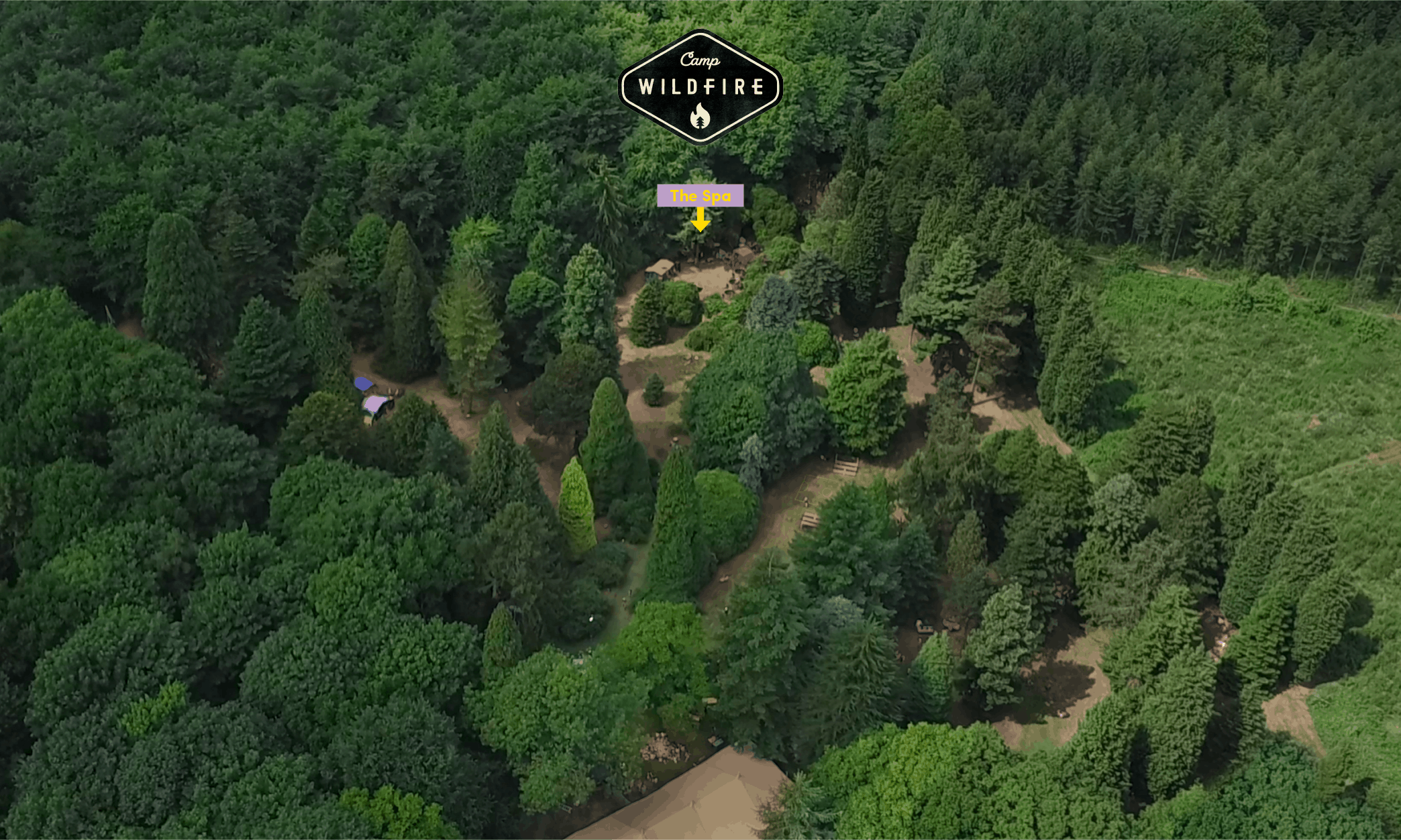 Drone shot of Camp Wildfire. A summer weekend break in a forest near London and Kent. An outdoor woodland retreat featuring adventure activities, live music, DJs, parties and camping. Half summer adventure activity camp, half music festival, for adults only.
