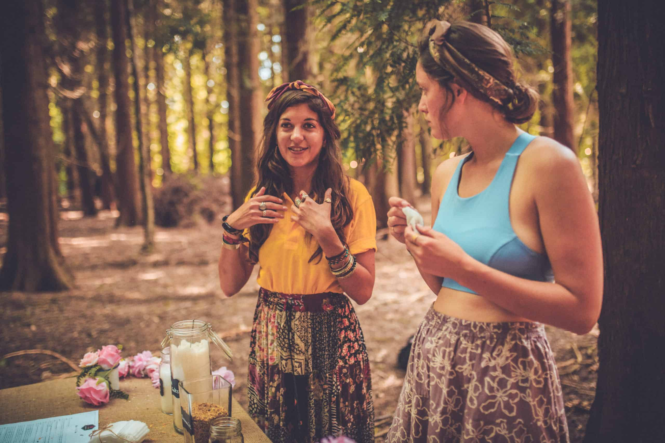 Girls at the Camp Wildfire woodland Apothecary. A summer weekend break in a forest near London and Kent. An outdoor woodland retreat featuring adventure activities, live music, DJs, parties and camping. Half summer adventure activity camp, half music festival, for adults only.