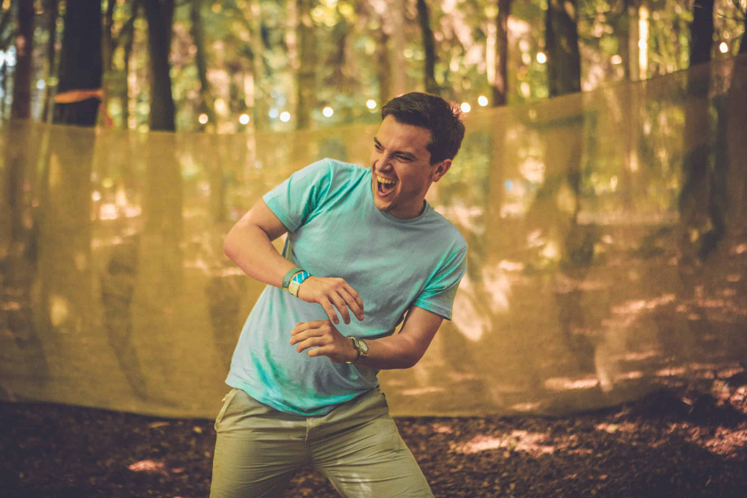 A man dodges an oncoming ball in a dodgeball game. A summer weekend break in a forest near London and Kent. An outdoor woodland retreat featuring adventure activities, live music, DJs, parties and camping. Half summer adventure activity camp, half music festival, for adults only.