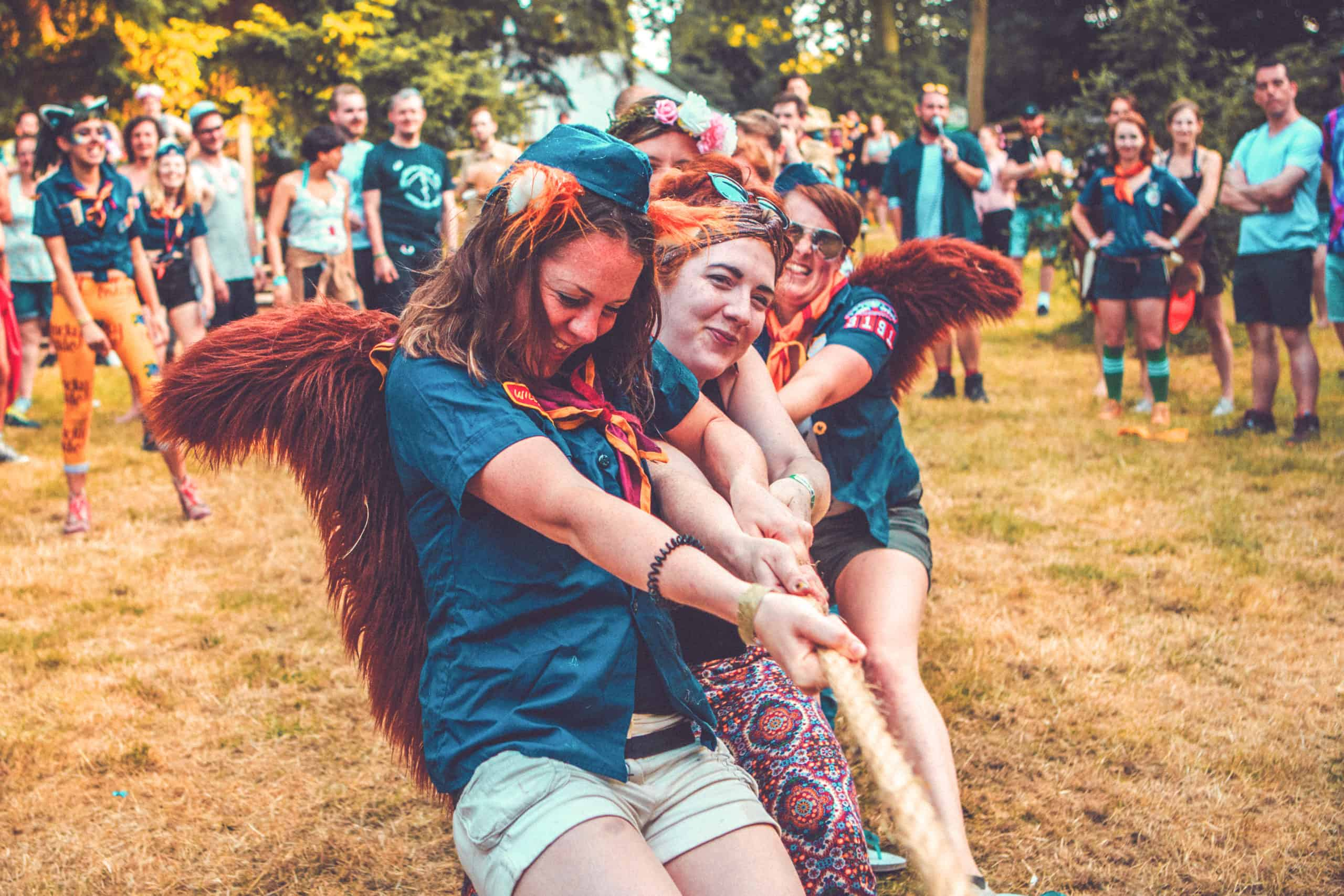 People dressed as foxes at the tug of war at Camp Wildfire. A summer weekend break in a forest near London and Kent. An outdoor woodland retreat featuring adventure activities, live music, DJs, parties and camping. Half summer adventure activity camp, half music festival, for adults only.
