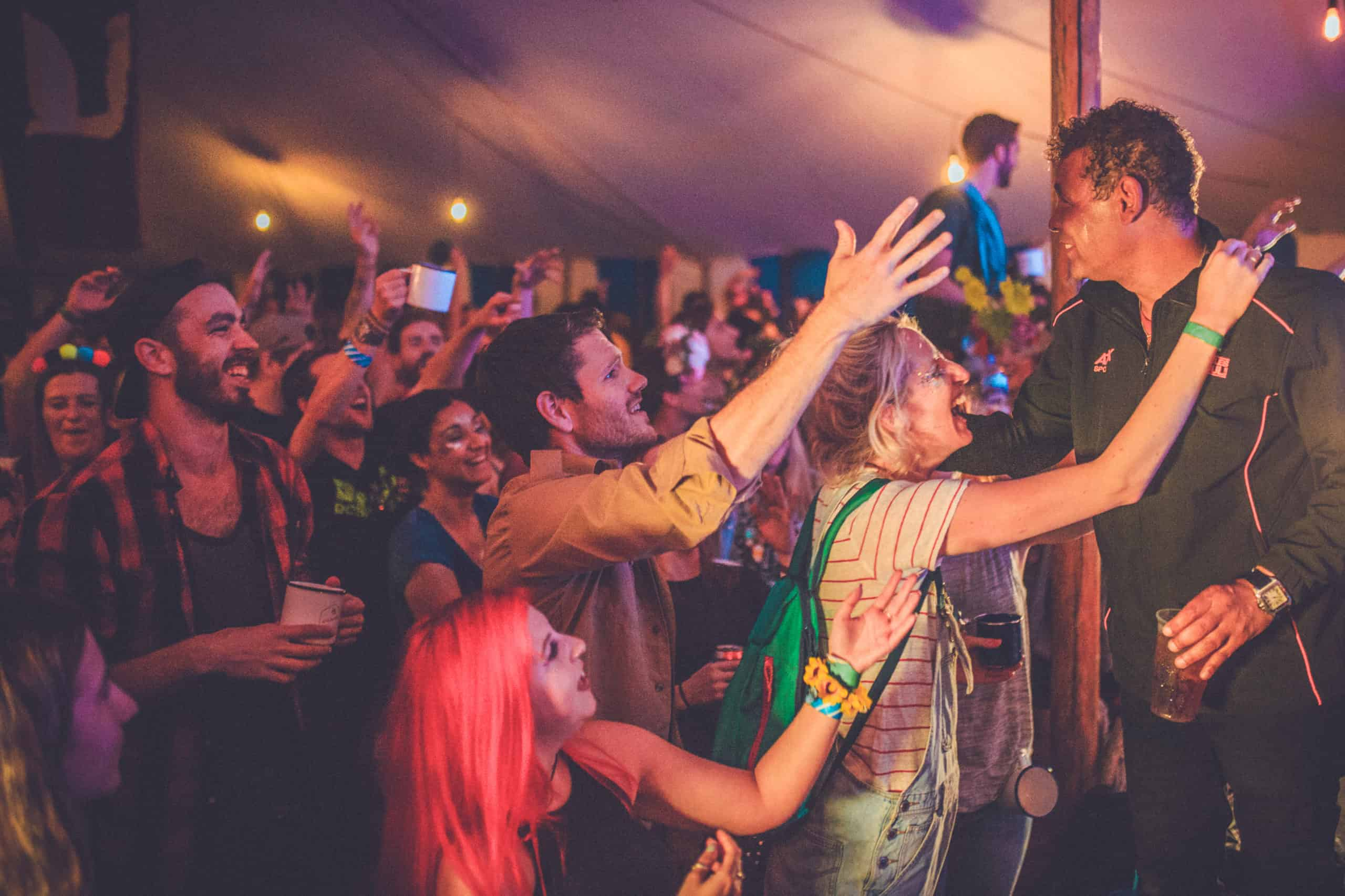 Craig Charles with the Camp Wildfire crowd. A summer weekend break in a forest near London and Kent. An outdoor woodland retreat featuring adventure activities, live music, DJs, parties and camping. Half summer adventure activity camp, half music festival, for adults only.