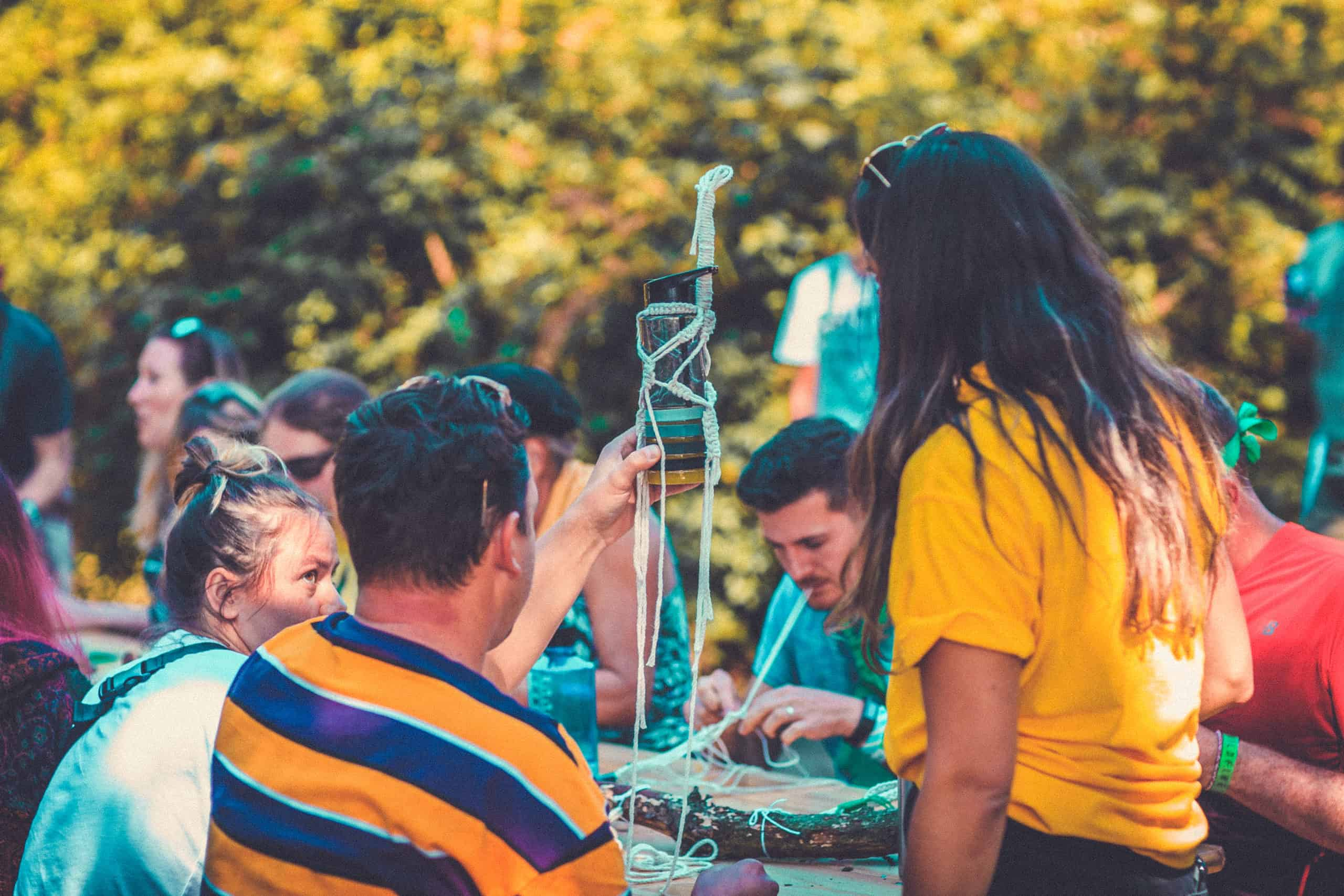 Macrame activity at Camp Wildfire. A summer weekend break in a forest near London and Kent. An outdoor woodland retreat featuring adventure activities, live music, DJs, parties and camping. Half summer adventure activity camp, half music festival, for adults only.