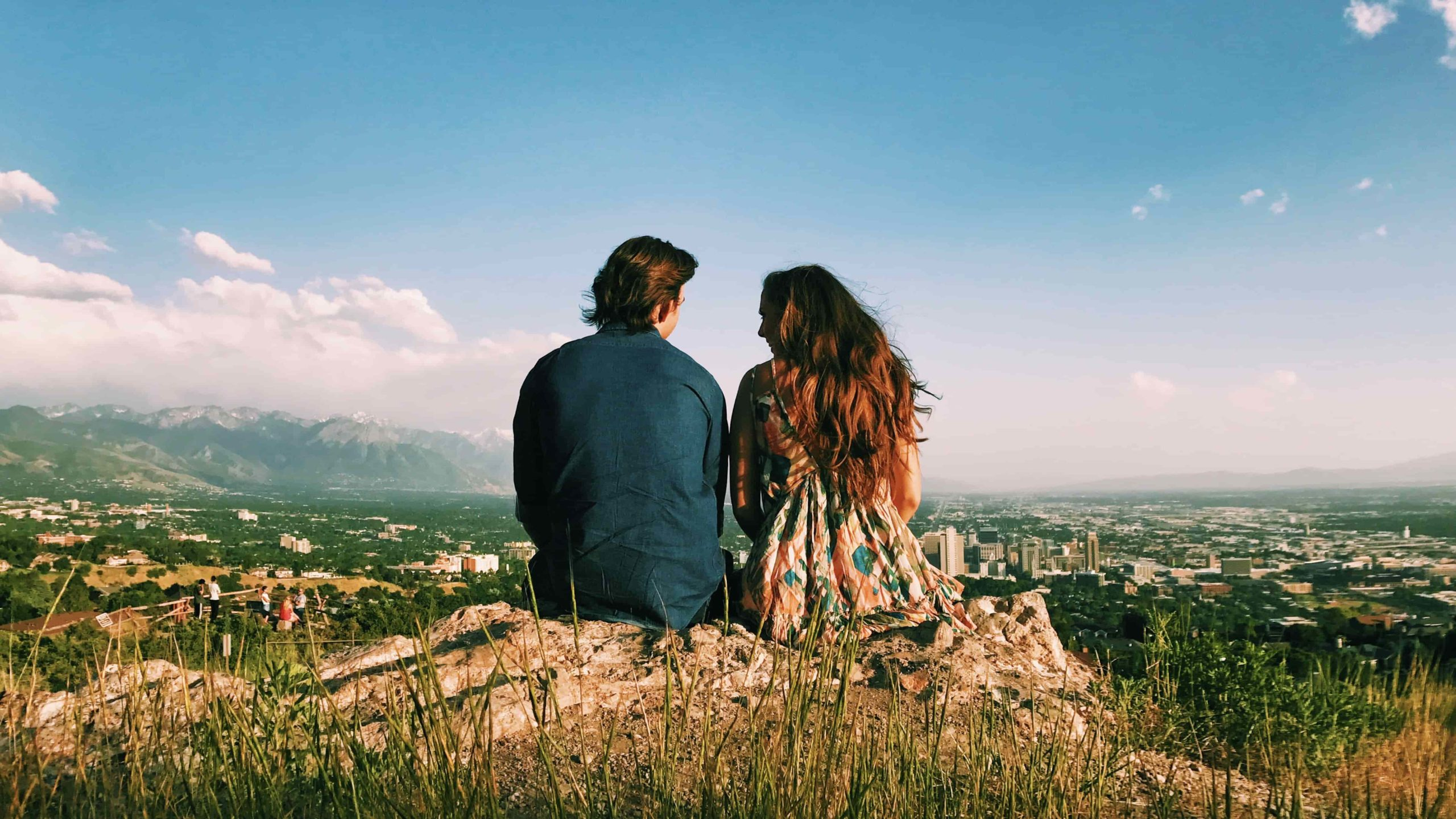 romantic couple on hill taking