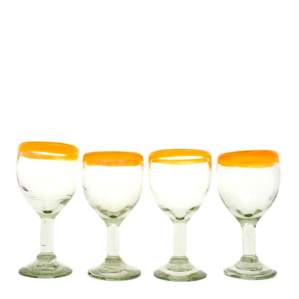clear with a yellow rim wine glass hand made in Mexico from recycled glassware