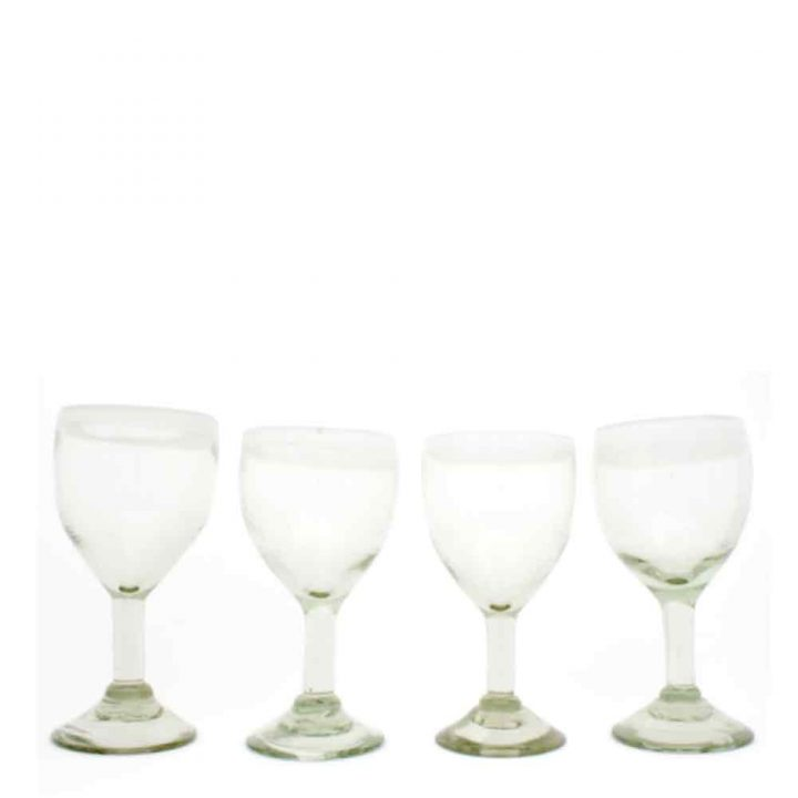 clear with a white rim wine glass hand made in Mexico from recycled glass